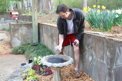 Trey seals the old birdbath, so that it will once again hold water. Lachance home by Donna Lachance 011