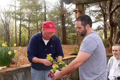 Rob and Charlie place bedding flowers into the garden, as Frank watches. Lachance home by Donna Lachance 015