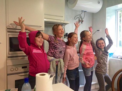 Girls singing for us in our kitchen