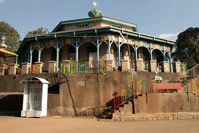 An orthodox church at the top of mount Entoto.  Mount Entoto is the highest peak overlooking the city of Addis Ababa, the capital of Ethiopia. Mount Entoto is part of the Entoto mountain chain, reaching 3,200 meters above sea level. It is also a historical place where Menelik II resided and built his palace, when he came from Ankober and founded Addis Ababa. It is considered a sacred location and holds many monasteries.  Articles of historical significance that were donated by members of the royal family, foreign diplomats and individuals are well displayed in the Entoto Museum. Architectural design and the inner wall paintings of the church are fascinating.