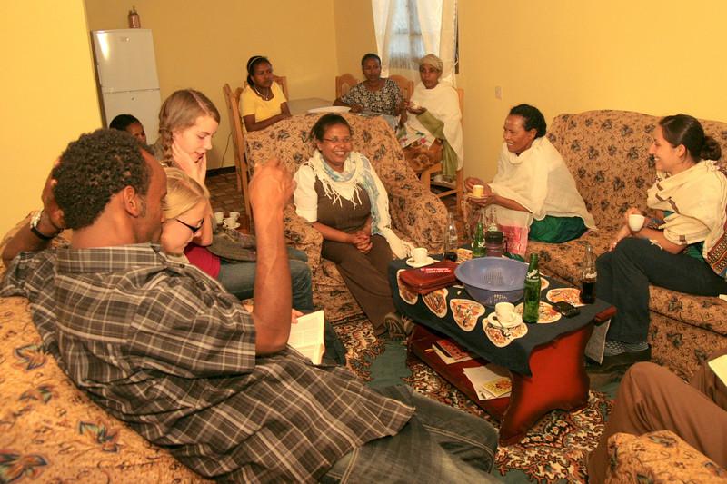 "Enjoying ""bunna"" (coffee), popcorn and fellowship at Alemnesh's home."