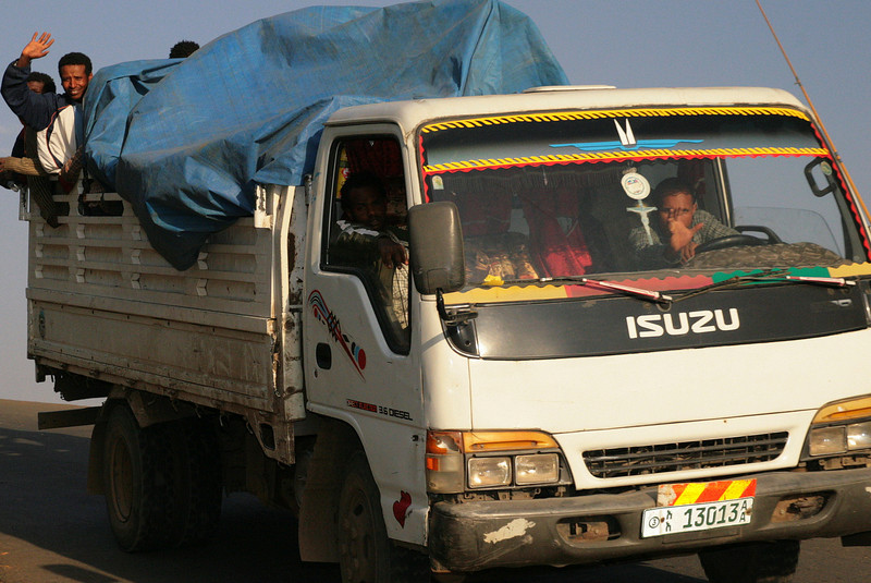 Often told not to take pictures of Ethiopians without permission, I snapped off this candid of a passing truck descending from mount Entoto. I see at least two friendly faces and waiving hands greeting the foreigner. Maybe they are more friendly than I was led to believe ;-)