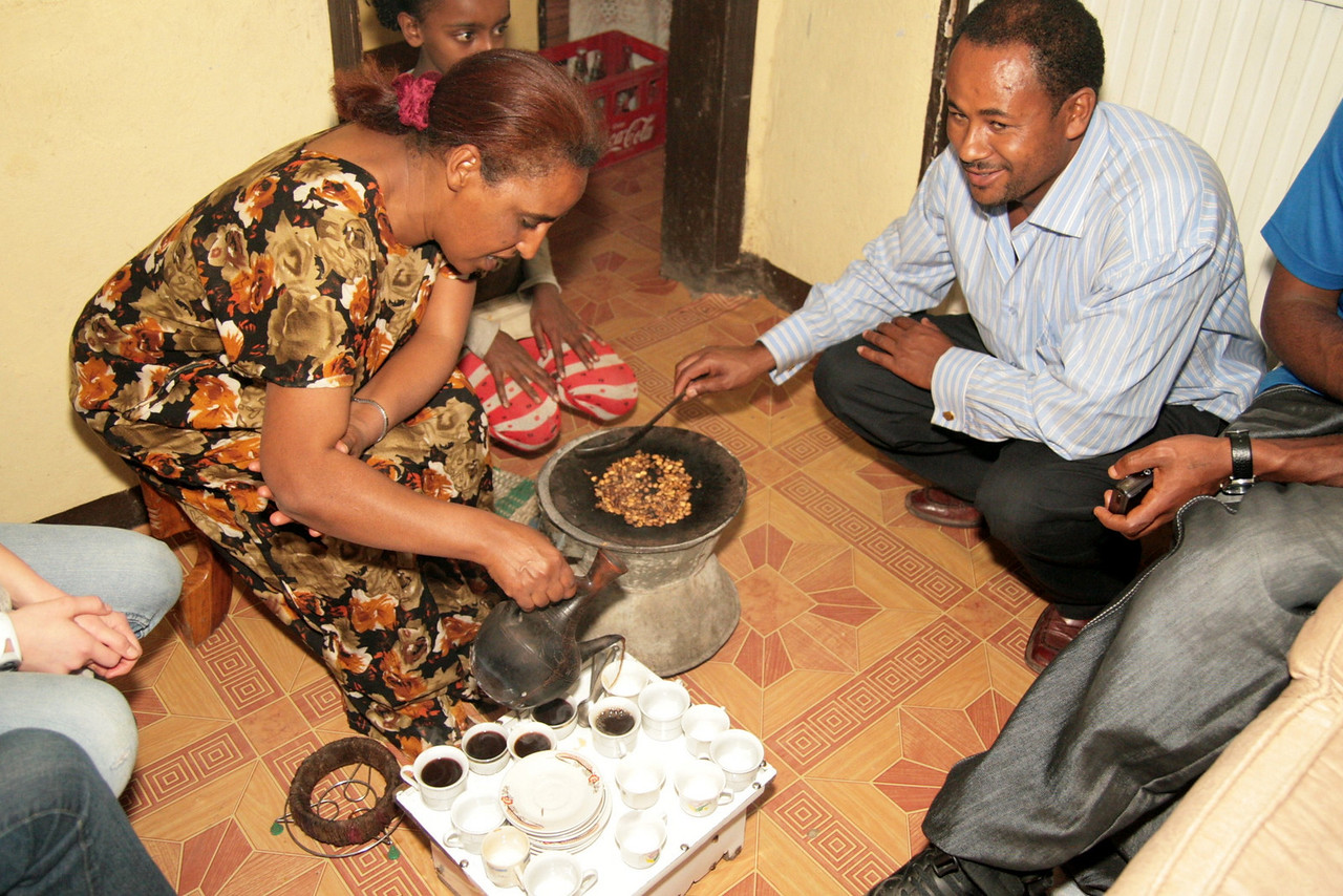 "Dinner at the Heyi's included a traditional coffee (""bunna"") ceremony. Those are fresh Ethiopia coffee beans cooking. Oh! The coffee was good in Ethiopia!"