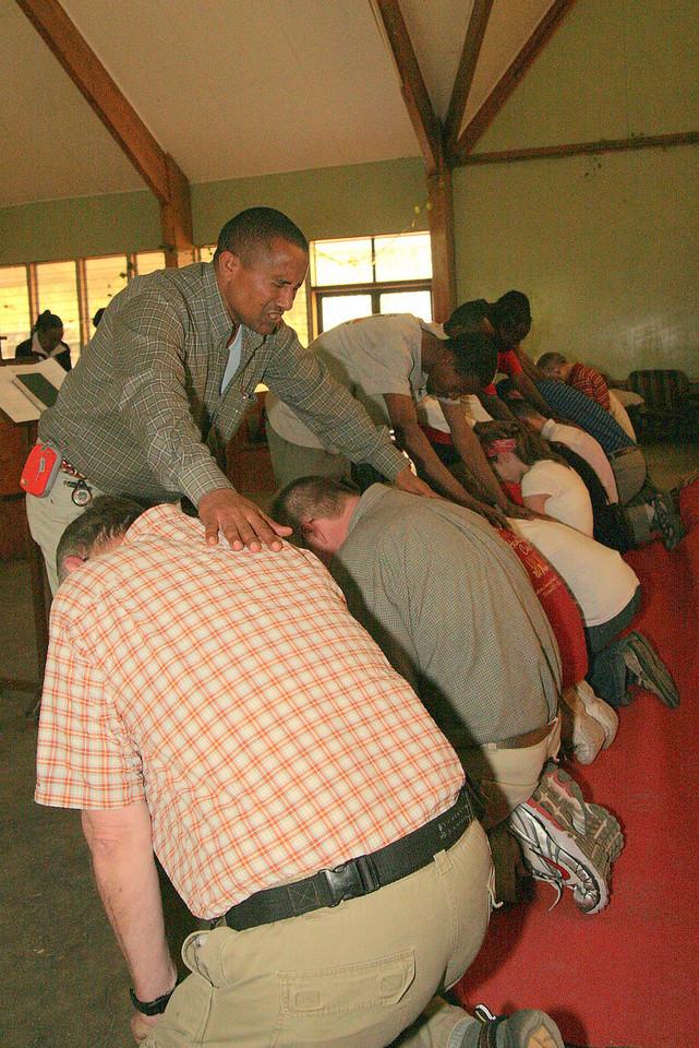 Members of MAKBC graciously pray blessings over their American brethren.