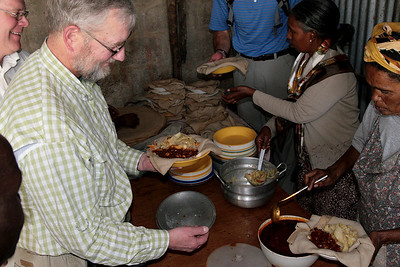 Here you can see foods portioned out on top of injera bread. You tear off a piece of injera and use it to pick up the prepared foods.