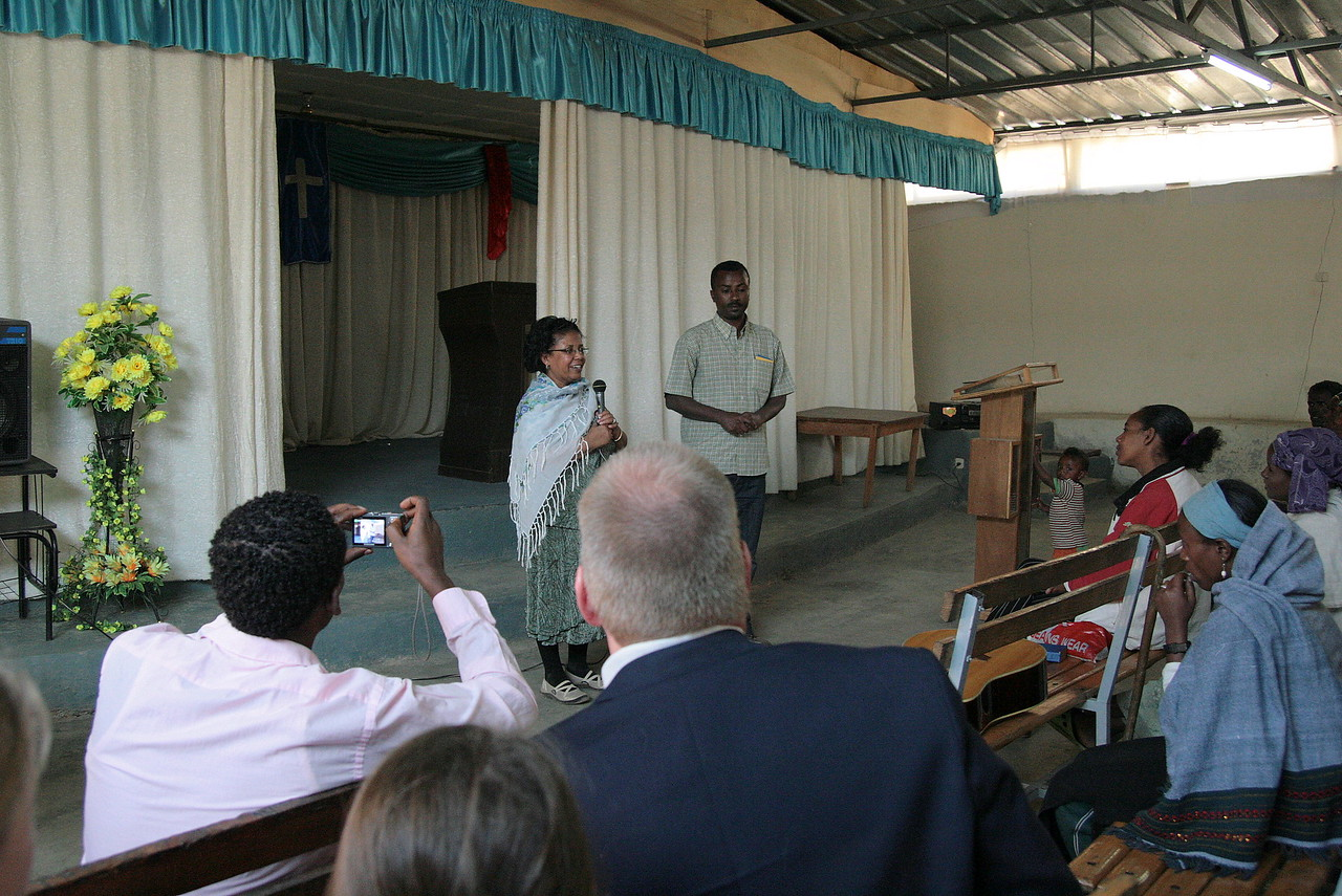 Alemnesh Heyi delivers greetings to the Mekanisa Addis Kidan Baptist Church (MAKBC).