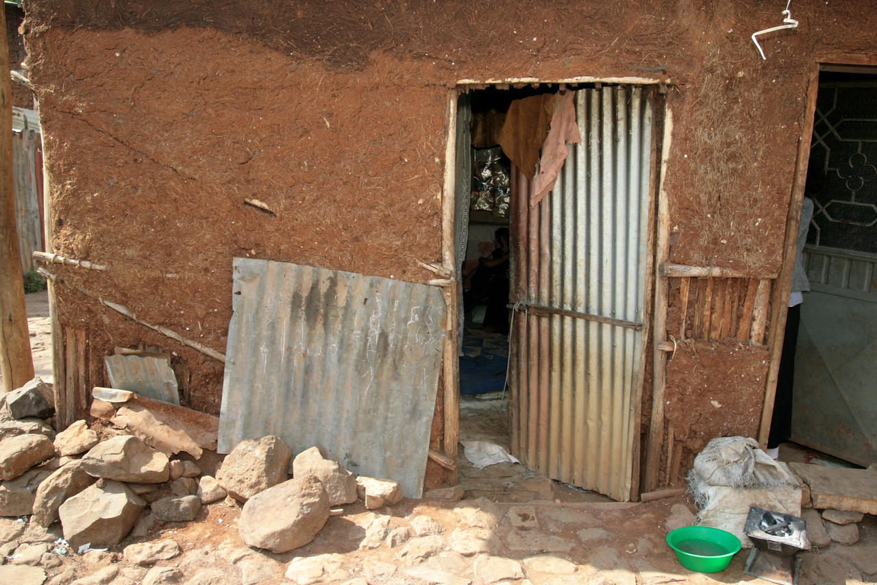 """These are the housing conditions of the poorest of the poor in Ethiopia. Our visit was to interview the family for child sponsorship. Sponsorship side-steps costly orphanages and gets needed funds directly to child and family. At an exchange rate of about 12 """"burr"""" per U.S. dollar, monthly contributions through child sponsorship can really provide a step up for families like these."""