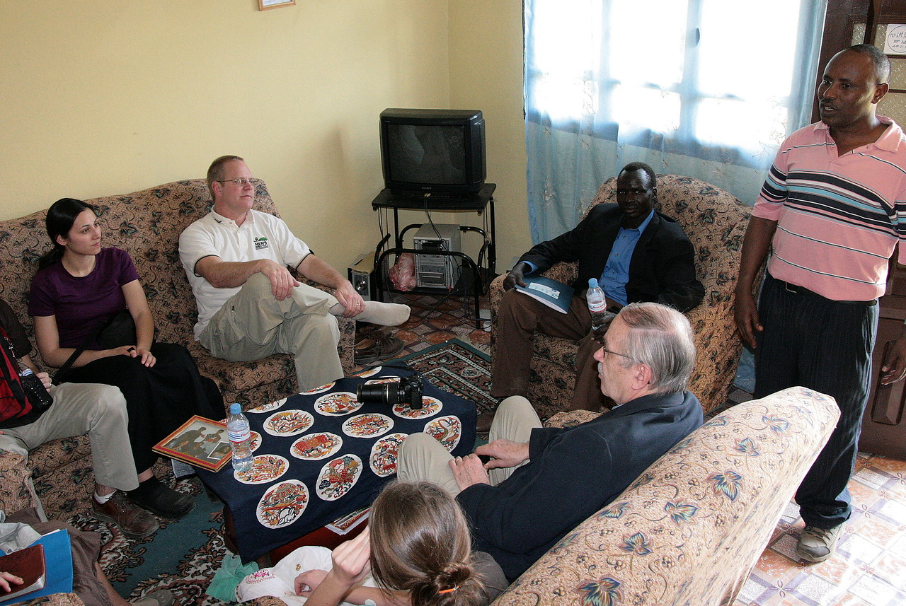 The team enjoys bunna (coffee) in Alemnesh's living room. The MAKBC church often uses her house for small group gatherings and leadership training.