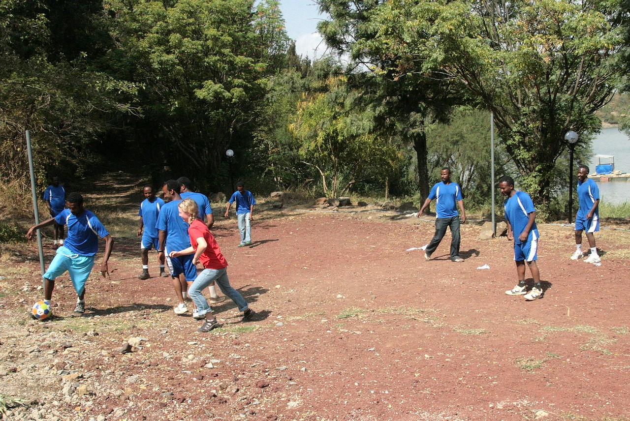 Now the teams begin recreation at a lake & park retreat.