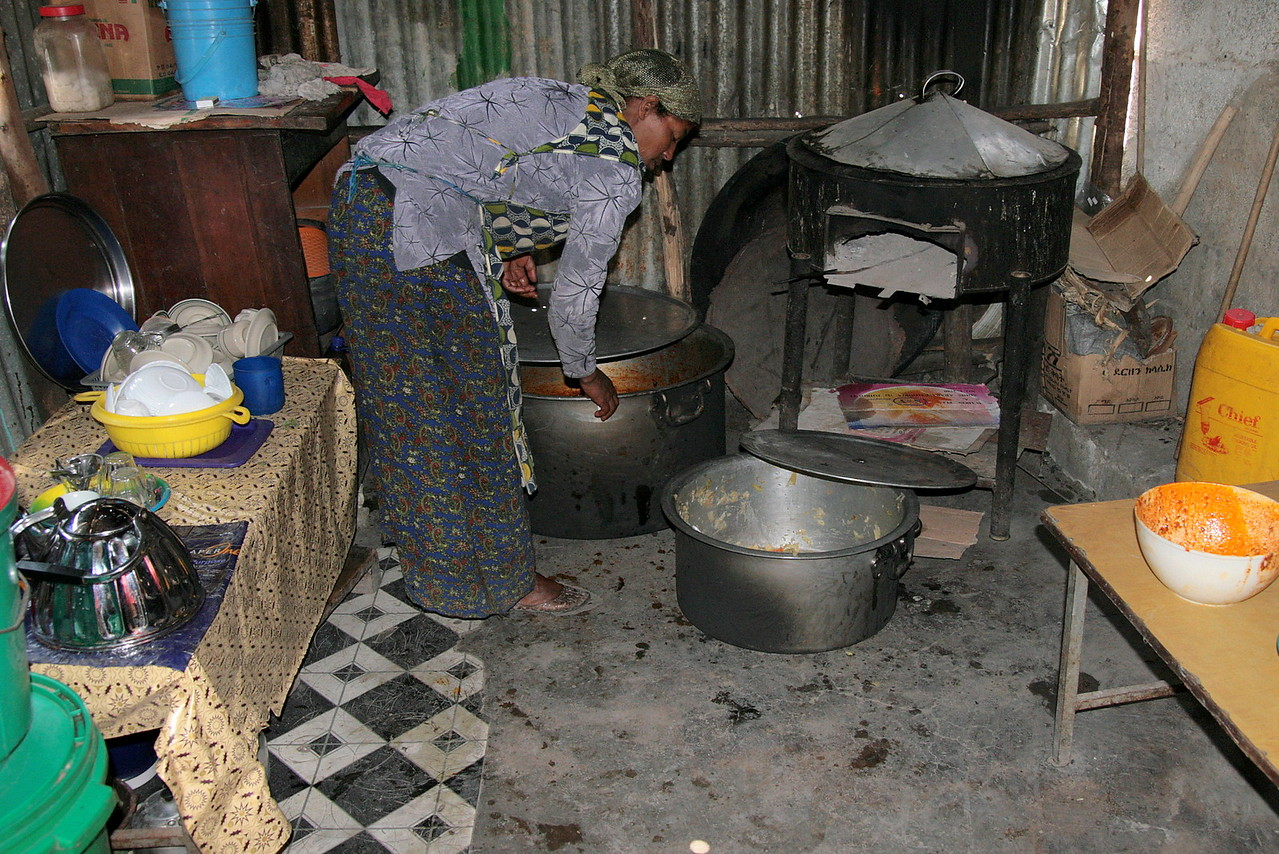 The large covered stove in the background is for cooking injera (an Ethiopian flat bread that is used to serve food on and to pick up for eating - because you eat with your hands!).