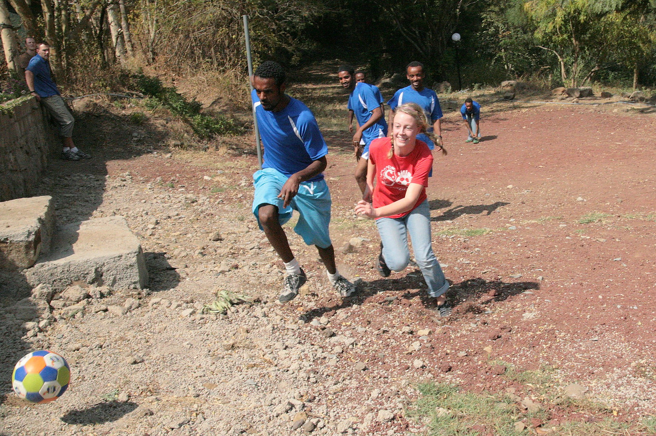 American, Emma Button, is giving those young Ethiopian guys a workout!