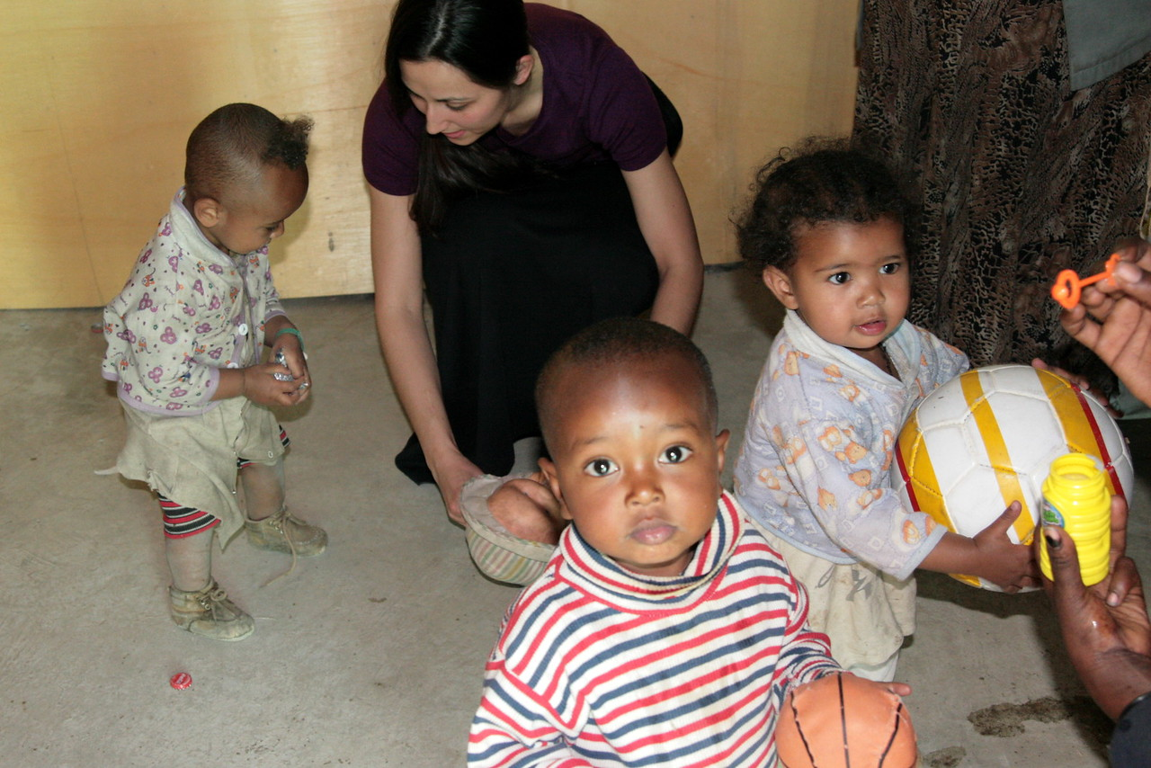 Christy Ivy shares tender moments with little ones from the neighborhood.