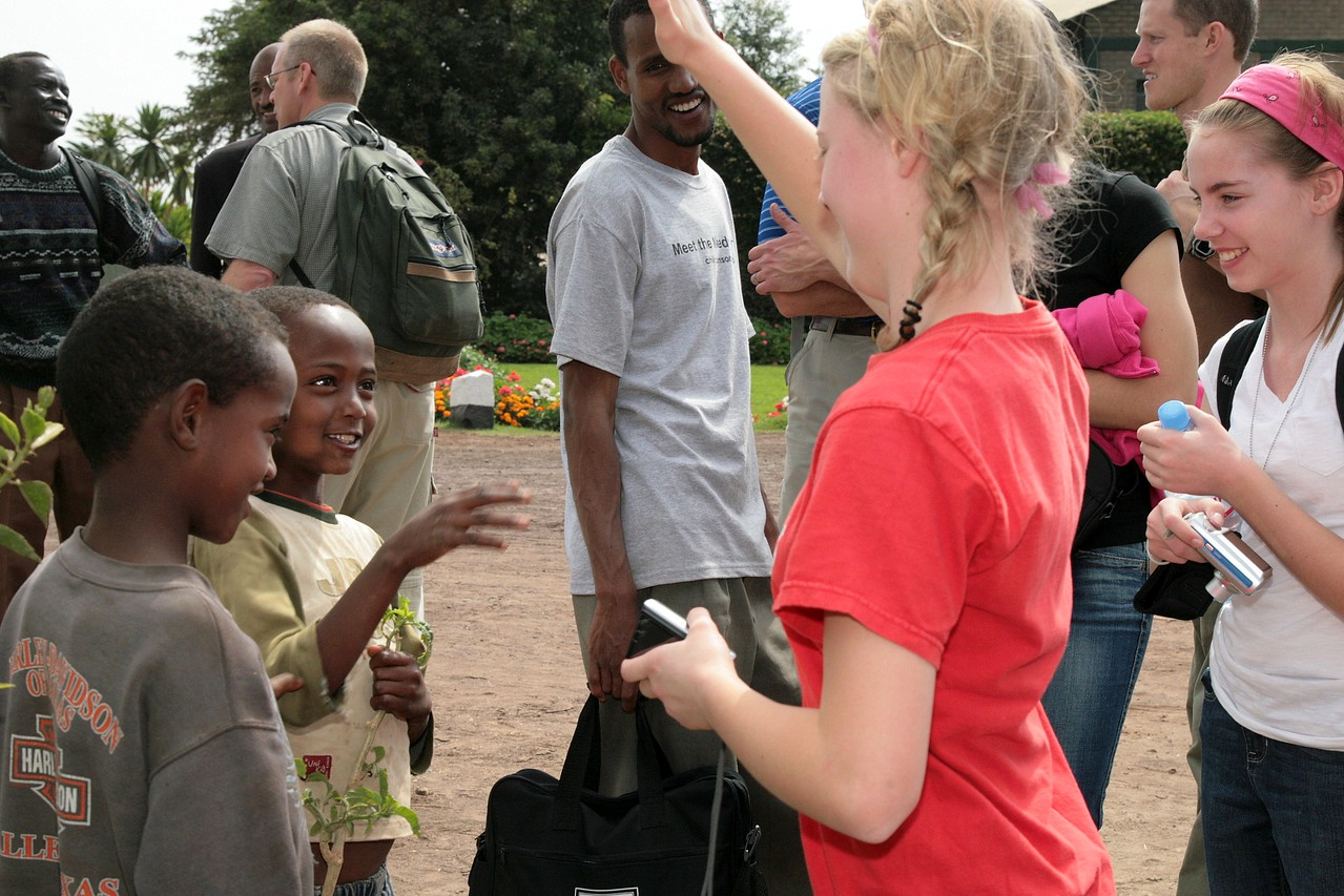 Emma Button and Jenna Wyman share some good-humor with local Ethiopian boys.