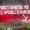 "Wall poet-ry - ""The poor are many, therefor it is impossible to forget them.""  Roberto Sosa, famous Honduran poet."