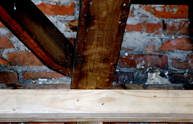 """Detail of joint at back of bathroom on chimney showing support of roof """"truss""""."""