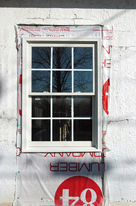 Front Window showing removed siding below window