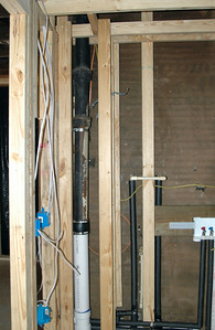 Laundry room with sewer vent enclosure wall