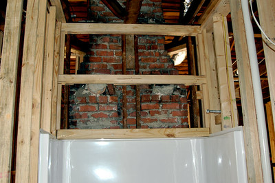Closeout around chimney vents above shower/tub.