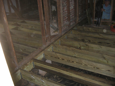 Two rooms with floor joists.