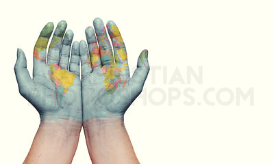 Two hands with earth