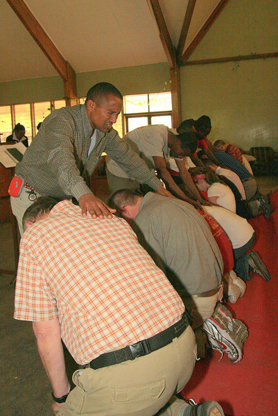 "<div align=""left"">Members of MAKBC graciously pray blessings over their American brethren.</div>"