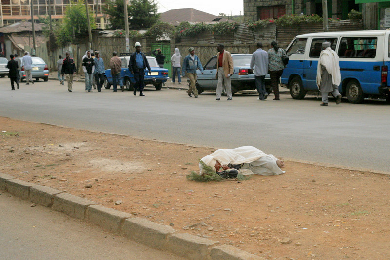 This is not an uncommon site in Addis Ababa. There are many homeless, and they have no where to go except on the street itself.