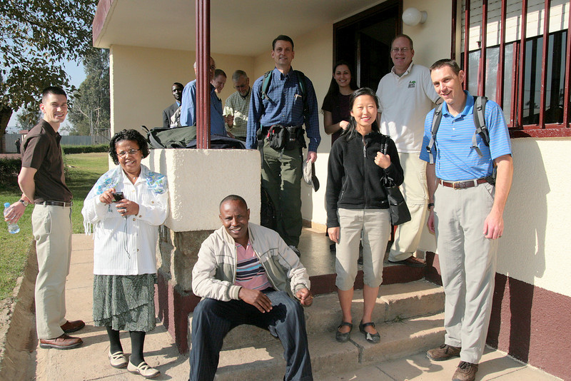 """<div align=""""left"""">Some of the team gathered on the front steps.</div>Counter clockwise from left: Robert Ivy, Alemnesh Heyi, Fikadu Heyi, Susan Lim, Mike Meyer, Brad Nelson, Christy Ivy, Paul Wallin."""