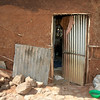 "These are the housing conditions of the poorest of the poor in Ethiopia. Our visit was to interview the family for child sponsorship. Sponsorship side-steps costly orphanages and gets needed funds directly to child and family. At an exchange rate of about 12 ""burr"" per U.S. dollar, monthly contributions through child sponsorship can really provide a step up for families like these."