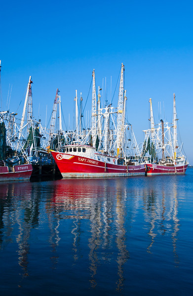 Colorful fishing trawlers docked in the harbor near Biloxi, Mississippi, USA, America.