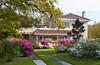 An elegant home with azalea shrubs in bloom near Gulfport, Mississippi, USA, America.