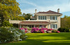 An elegant home with azalea shrubs in bloom near Gulfport, Mississippi, USA, America.