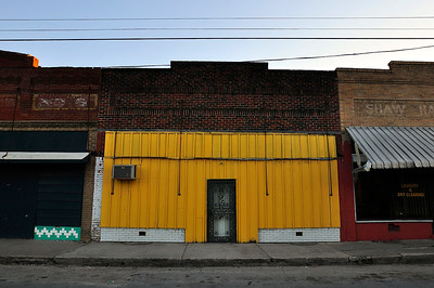 Main Street in Downtown Shaw, vibrant paint covers empty buildings with no names.
