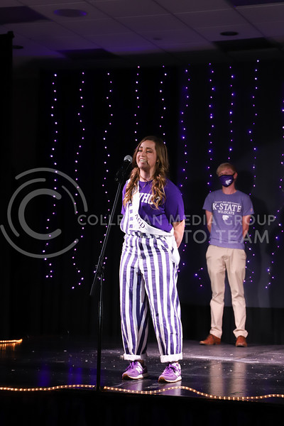 Alpha Gamma Delta representative Kaitlyn Uhlrich showing off her school pride in round one of the Miss.K-State competition. <br /> Elizabeth Proctor Collegian Media Group