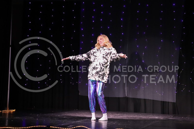 Zeta Tau Alpha representative Mayci Armstrong performing a breakdance routine in round two (talent) at the Miss.K-State competition. <br /> Elizabeth Proctor Collegian Median Group