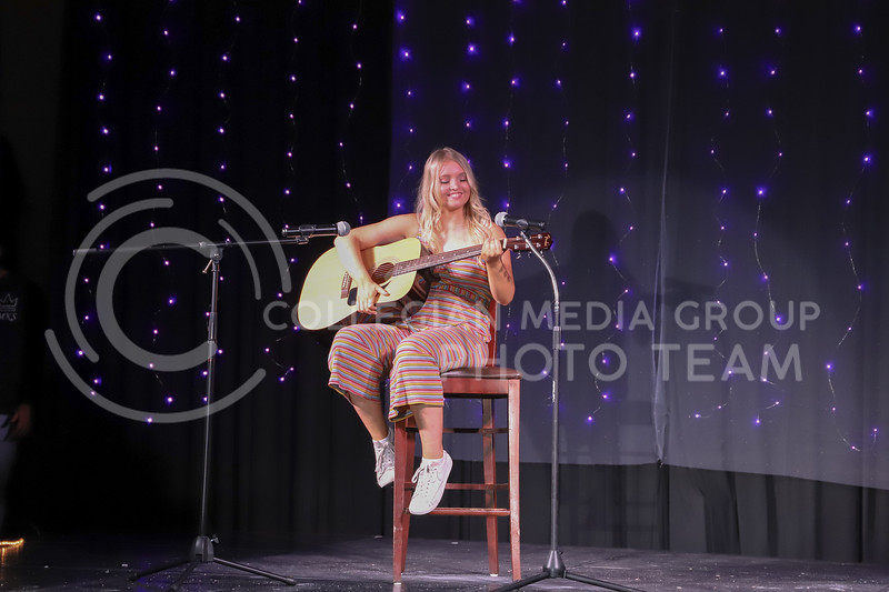 Kappa Delta representative Ava Hauser performing a song to guitar in round two (talent) at the Miss.K-State competition. <br /> Elizabeth Proctor Collegian Median Group