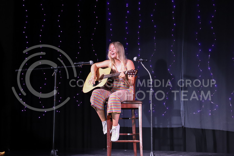 Kappa Delta representative Ava Hauser performing a song to the guitar in round two (talent) at the Miss.K-State competition. <br /> Elizabeth Proctor Collegian Median Group