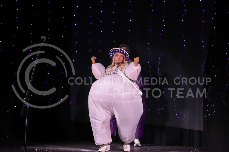 Kappa Delta representative Ava Hauser showing off her school pride in round one of the Miss.K-State competition. <br /> Elizabeth Proctor Collegian Media Group