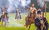 Confederate cavalry chase Union soldiers at Centralia, MO, 150th anniversary reenactment - C1-0357 - 72 ppi-2