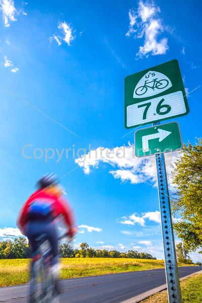 Fast rider on US 76 Bike Route--TransAmerica Trail near St  Mary's, Missouri - C2- - 72 ppi