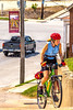 Cyclist climbing toward Gasconade County Courthouse in Hermann, Missouri - C3-0102 - 72 ppi-3