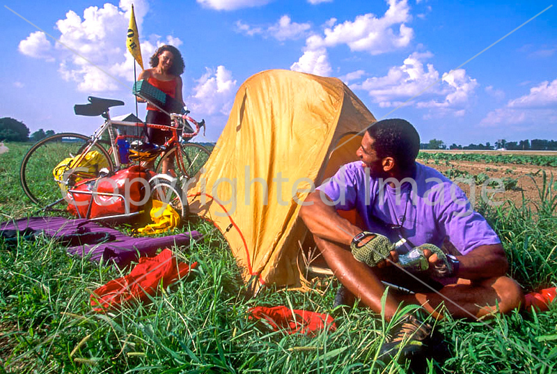 Touring cyclists setting up camp just west of St  Louis, Missouri - -9 - 72 ppi