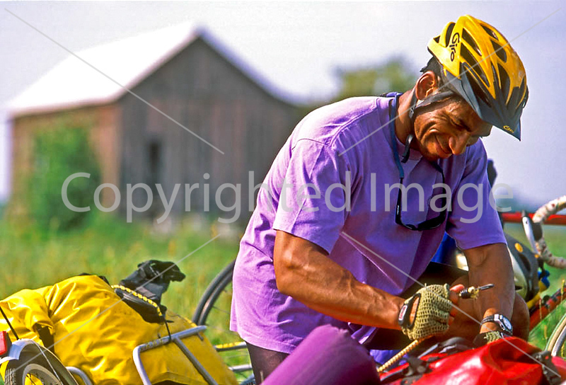 Touring cyclists setting up camp just west of St  Louis, Missouri - -6 - 72 ppi