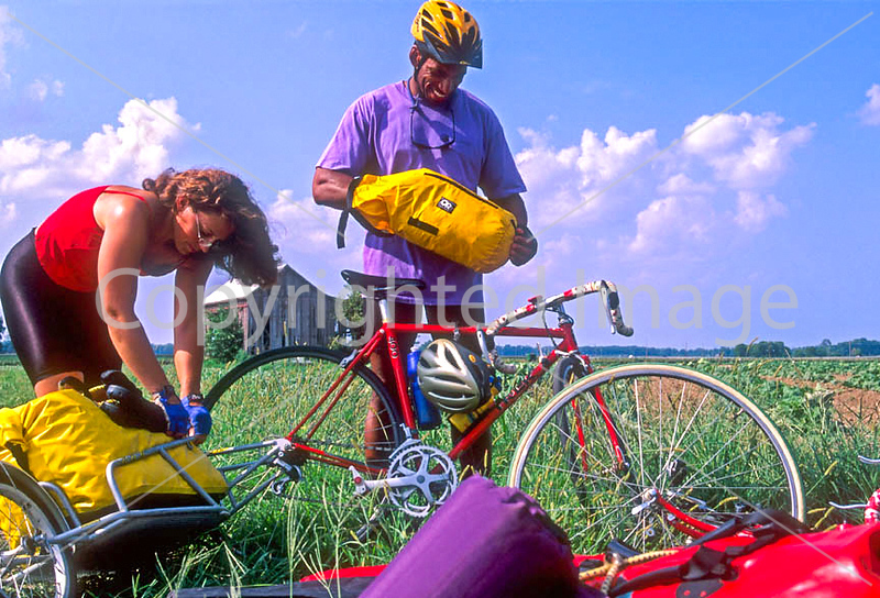 Touring cyclists setting up camp just west of St  Louis, Missouri - -12 - 72 ppi