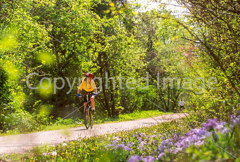 Cyclist on Katy Trail in St  Charles, MO - 1 - 72 ppi