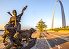 Cyclist, tourer, & Lewis & Clark statue on St  Louis waterfront - 72 ppi - 2