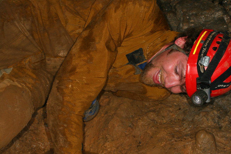 Here's Mike showing off his caving skills emerging from a narrow opening.