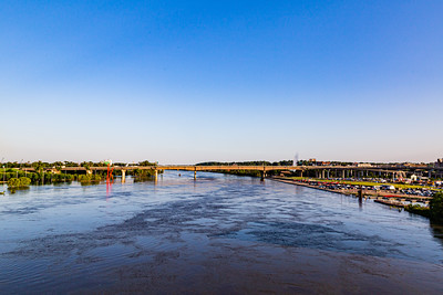 Missouri River flood of 2019 in Omaha Nebraska US, Swollen Missouri River flowing under the Douglas Street Bridge