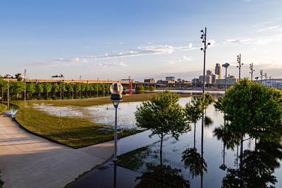 Missouri river flood of 2019 at Omaha Nebraska, Swollen Missouri River overflowing its banks and flooding the Omaha riverfront and Tom Hanafan plaza  in Council Bluffs Iowa. Trees reflections in flood water