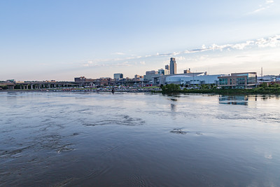 Missouri river flood of 2019 at Omaha, Omaha Monument to Labor, submerged in flood water, Swollen Missouri river, Douglas Street Bridge Omaha, Riverfront condominiums, Carl T. Curtis, Regional headquarters National Park service, on the right, Closed Park sign, City of Omaha skyline