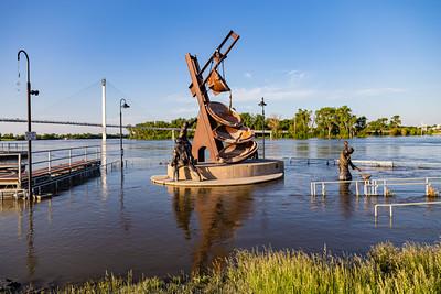 Missouri river flood of 2019, Omaha Monument to Labor, submerged in flood water, Swollen Missouri river, Bob Kerrey foot bridge,  City of Omaha,